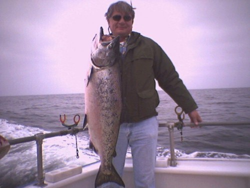 Steve Woodill of San Juan Baptista holding his 31 pounder caught on May 26, 2004, one of the biggest salmon the season on the Queen of Hearts