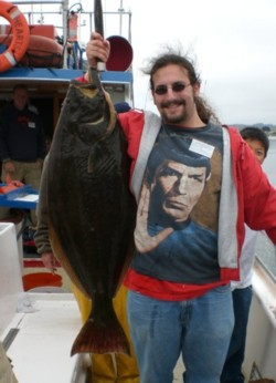 Josh House holds the 32 pound halibut he scored on a shallow water rockfishing trip on August 8, 2007